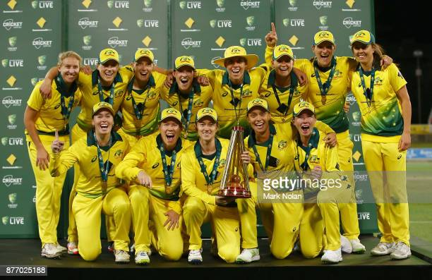 The Australian team pose for a photo after being presented with the Ashes after the Third Women's Twenty20 match between Australia and England at...