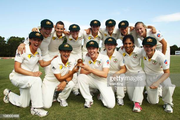 The Australian team pose with the Ashes trophy after winning the match during day four of the Women's CBA Test match between Australia and England at...