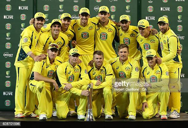 The Australian team pose with the ChappellHadlee Trophy after winning game three and the series of the One Day International series between Australia...