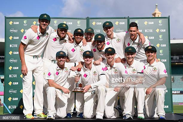 The Australian team pose with the Frank Worrell Trophy after winning the series during day five of the third Test match between Australia and the...