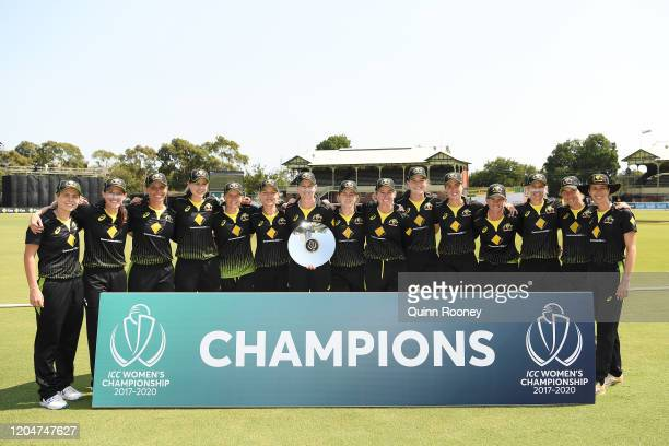 The Australian team pose with the ICC Women's Championship Trophy during game five of the Women's One Day International series between Australia and...
