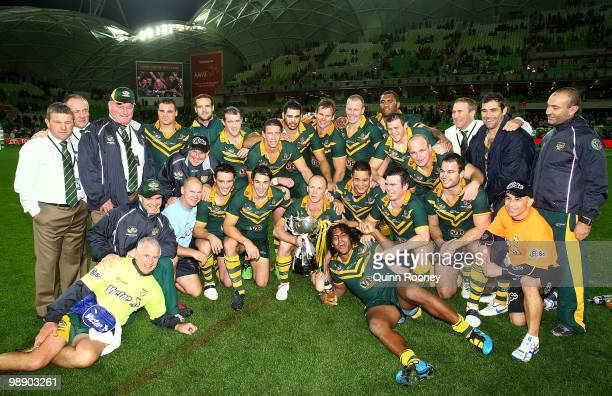 The Australian team pose with the trophy after winning the ARL Test match between the Australian Kangaroos and the New Zealand Kiwis at AAMI Park on...