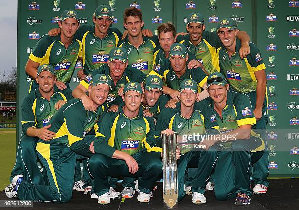 The Australian team pose with the trophy after winning the final match of the Carlton Mid One Day International series between Australia and England...