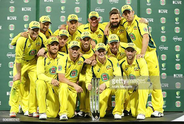 The Australian team pose with the winners trophy after winning the series after game five of the Commonwealth Bank One Day Series match between...