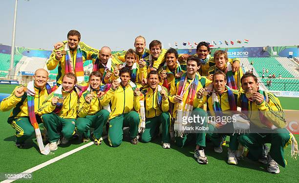 The Australian team pose with their gold medals after winning the Men's Gold medal match between Australia and India at the Major Dhyan Chand...
