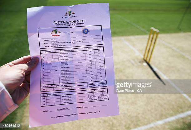 The Australian Team sheet is seen with the late Phillip Hughes named 13th man during day one of the First Test match between Australia and India at...