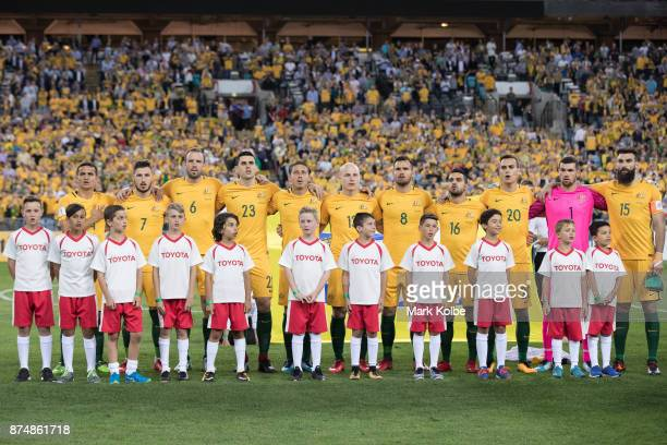 The Australian team sing the national anthem before the 2018 FIFA World Cup Qualifiers Leg 2 match between the Australian Socceroos and Honduras at...