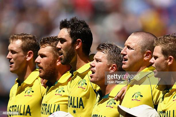 The Australian team sing the national anthem during the 2015 ICC Cricket World Cup match between England and Australia at Melbourne Cricket Ground on...