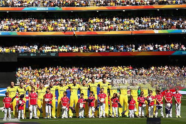 The Australian team sing their national anthem during the 2015 ICC Cricket World Cup final match between Australia and New Zealand at Melbourne...