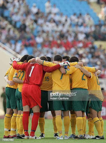 The Australian team stand in a group huddle prior to the start of the AFC Asian Cup 2007 Quarter Final between Japan and the Australian Socceroos at...
