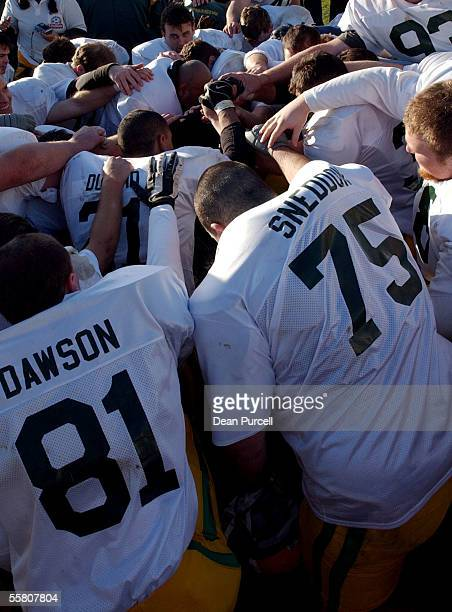 The Australian team take time to pray after their win in the American Football match between the New Zealand Iron Blacks and Australia played at Eden...
