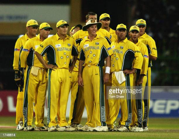 The Australian team wait for the third umpire's decision during the ICC Champions Trophy semi-final match between Sri Lanka and Australia held on...