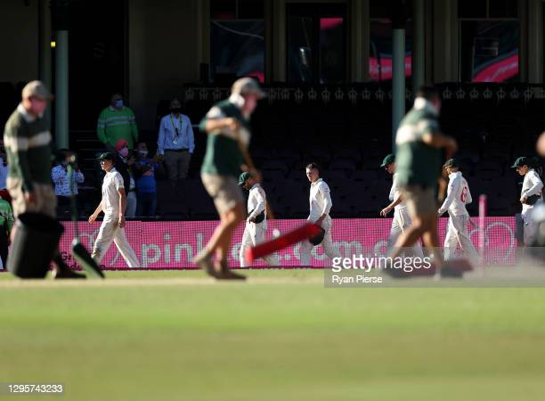 The Australian team walk from the ground after the match ended in a draw during day five of the 3rd Test match in the series between Australia and...