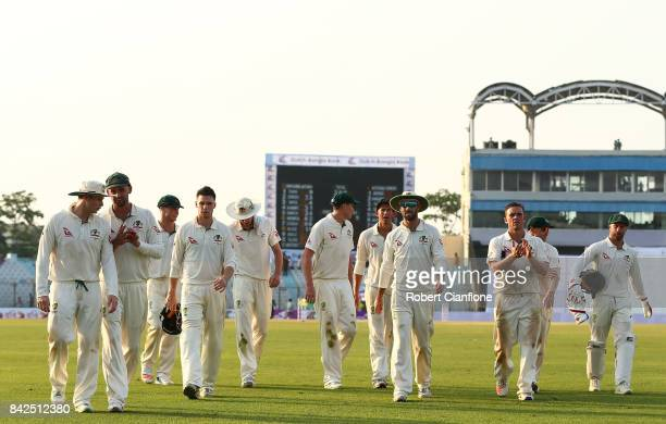 The Australian team walk off the ground at the end of play during day one of the Second Test match between Bangladesh and Australia at Zahur Ahmed...