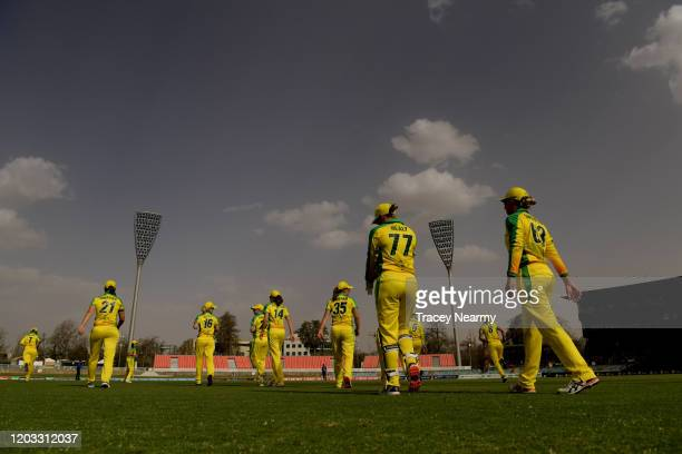 The Australian team walk out for the tie breaker during the Women's T20 TriSeries Game 2 between Australia and England at Manuka Oval on February 01...