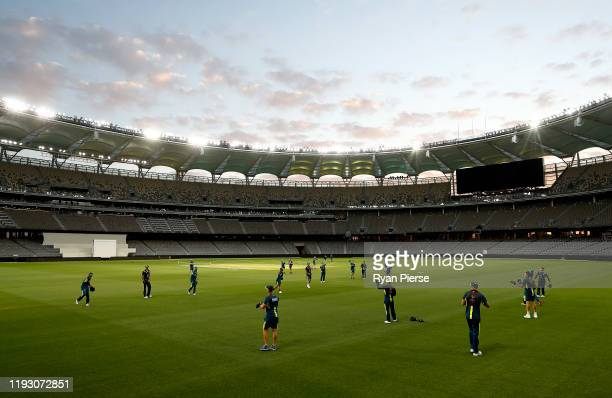 The Australian warm up on the pitch during an Australian Test team training session at Optus Stadium on December 10, 2019 in Perth, Australia.