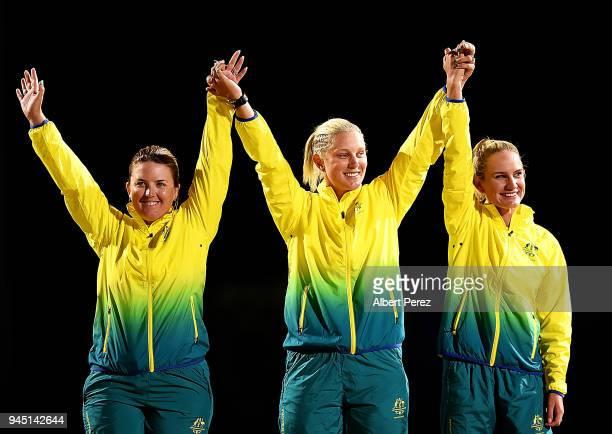 The Australian Women's Triples Lawn Bowls team of Rebecca van Asch Natasha Scott and Carla Krizanic pose after winning the Women's Triples gold medal...