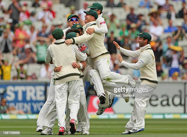 The Australians celebrate after Mitchell Johnson of Australia dismissed Tillakaratne Dilshan of Sri Lanka during day three of the Second Test match...