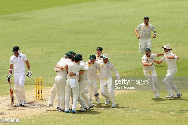 The Australians celebrate getting the final wicket of James Anderson of England and winning the match and the Ashes during day five of the Third...