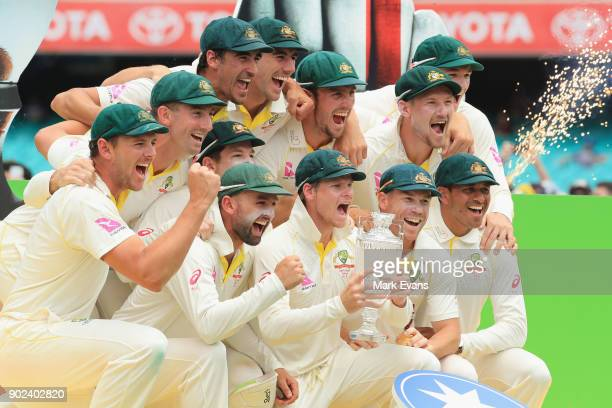 The Australians pose for a team photo after winning the Ashes during day five of the Fifth Test match in the 2017/18 Ashes Series between Australia...