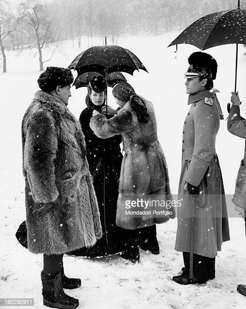The Austrian actor Helmut Berger and the Austrianborn French actress Romy Schneider listening to the directions given by the Italian director Luchino...