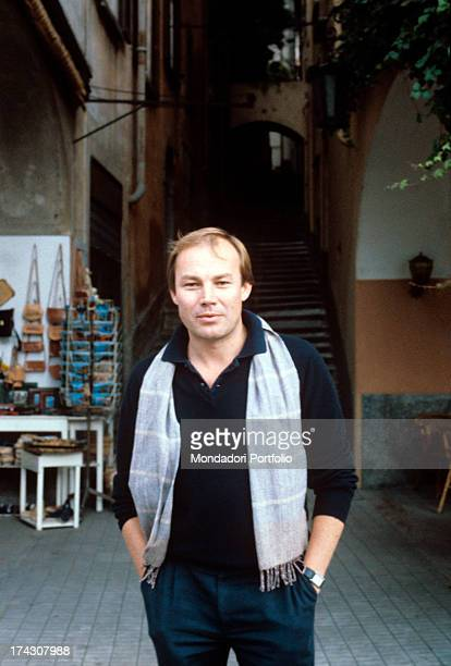The Austrian actor Klaus Maria Brandauer histrionic performer of various manysided roles poses in a picturesque glimpse behind him can be seen a...