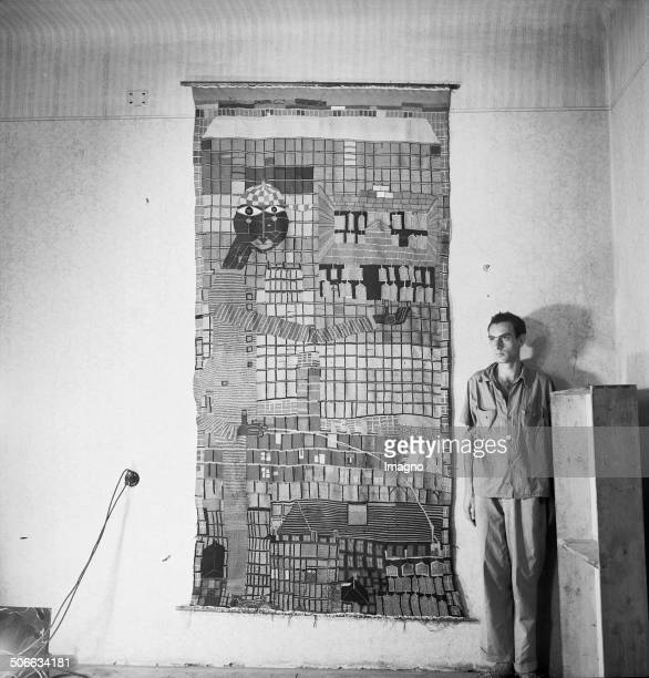 The Austrian artist Friedensreich Hundertwasser in his studio with the tapestry >Pissing boy with SkyScraper< About 1952