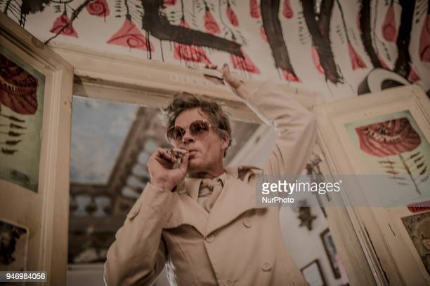 The austrian artist Uwe Jäentsch protest in the Vucciria neighborhood, in Palermo, before to leave Sicily before has to clear out his home, on April...