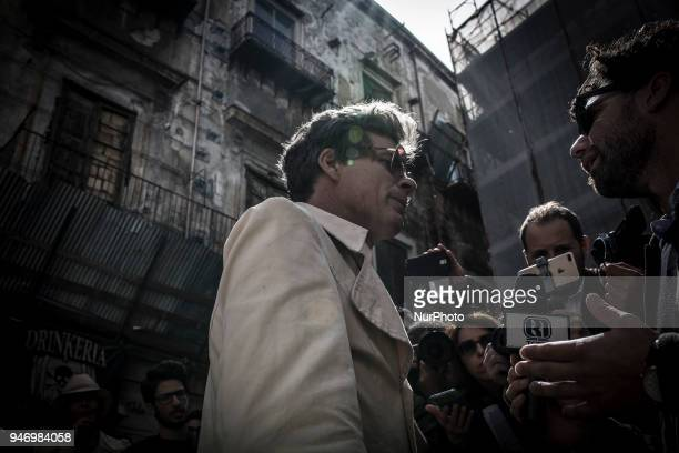 The austrian artist Uwe Jäentsch protest in the Vucciria neighborhood in Palermo before to leave Sicily before has to clear out his home on April 16...