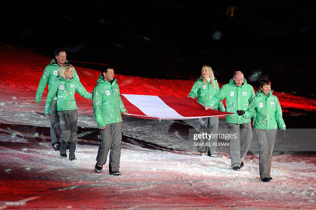 The Austrian delegation carries their country's flag during the opening ceremony of the FIS World Ski Championships on February 4, 2013 in Schladming.