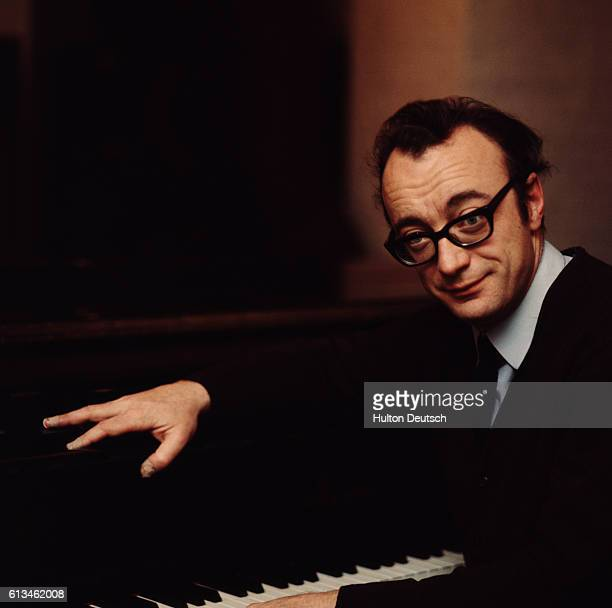 The Austrian pianist Alfred Brendel born in 1931 sits at a piano