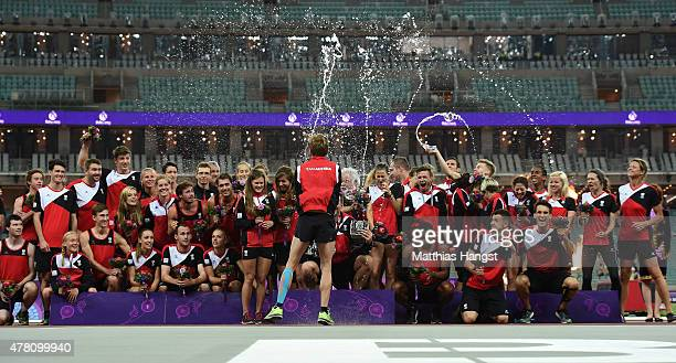 The Austrian team celebrate their silver medal in the Athletics Team Championship during day ten of the Baku 2015 European Games at the Olympic...