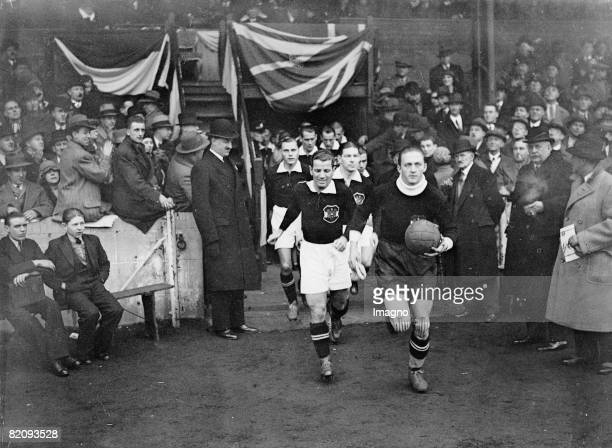 The Austrian team is running on to the field Soccermatch between England and Austria at Stamford Bridge Photograph England London December 1932 [Das...