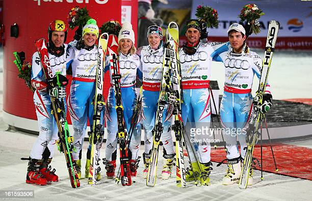 The Austrian team of Marcel Hirscher Nicole Hosp Michaela Kirchgasser Carmen Thalmann Philipp Schoerghofer and Marcel Mathis celebrate at the flower...