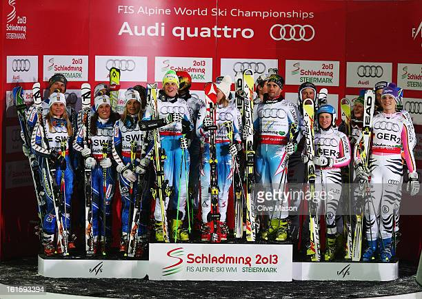 The Austrian team of Nicole Hosp Michaela Kirchgasser Carmen Thalmann Marcel Hirscher Marcel Mathis and Philipp Schoerghofer celebrate victory...