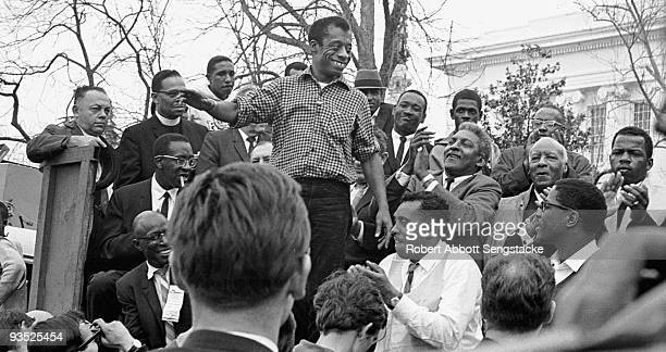 The author James Baldwin smiles while addressing the crowd from the speaker's platform after participating in the march from Selma to Montgomery in...