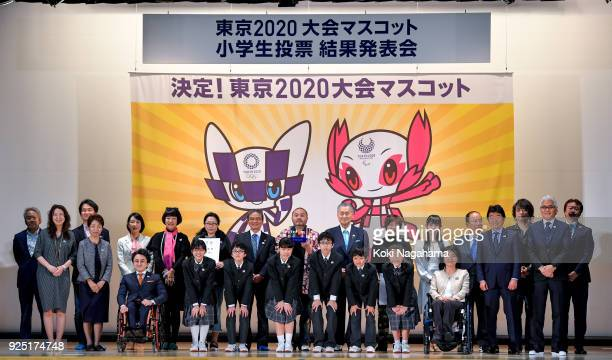 The author of mascot Ryo Tniguchi and Tokyo 2020 Organising Committee President Yoshiro Mori and Committee member and students pose for photographs...