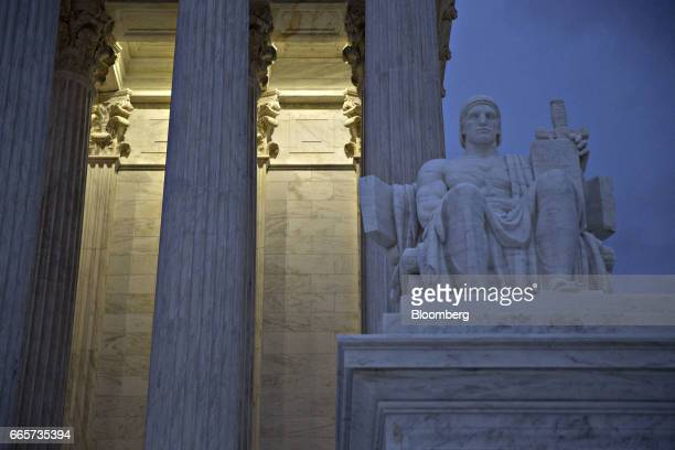 The 'Authority of Law' statue sits at the US Supreme Court building in Washington DC US on Friday April 7 2017 Judge Neil Gorsuch is poised to win an...