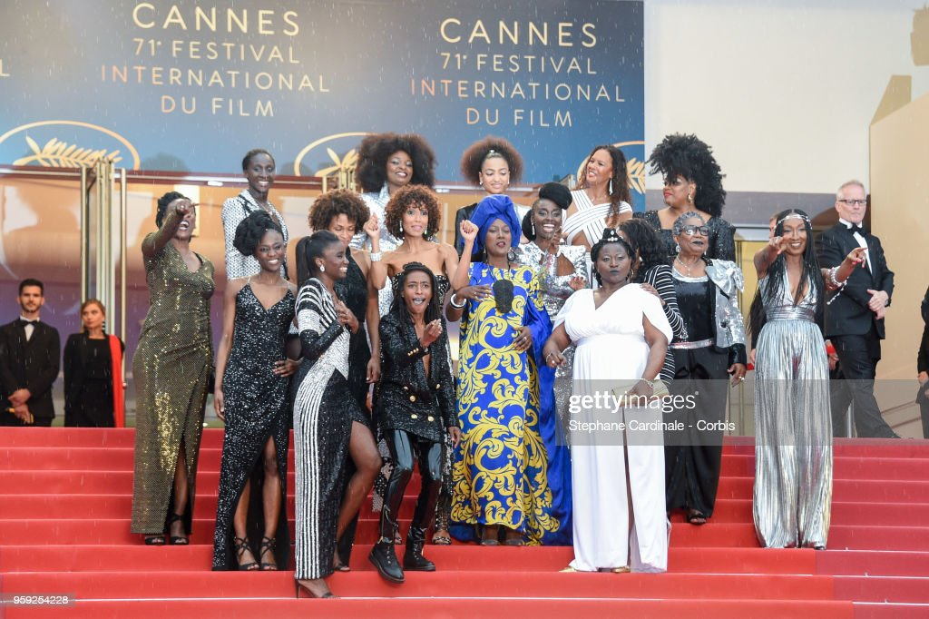 The Authors of the book 'Noire N'est Pas Mon MŽtier' (Black is Not My Job) dance on the stairs at the screening of 'Burning' during the 71st annual Cannes Film Festival at Palais des Festivals on May 16, 2018 in Cannes, France.