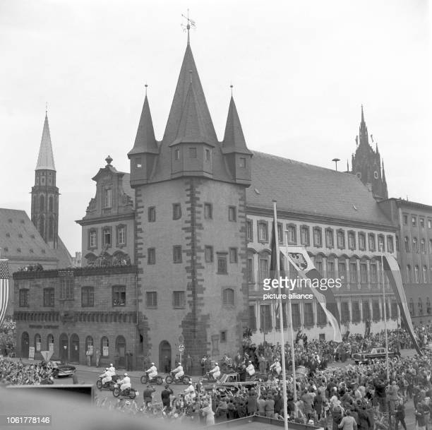 The autocade with US president John F Kennedy in Frankfurt am Main on 25 June 1963 passing the Rententurm a historical building near the city hall
