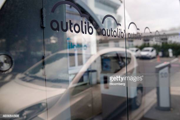 The Autolib' logo sits at an Autolib' charging station at the Autolib' carsharing headquarters in Vaucresson France on Monday March 9 2015 Vincent...