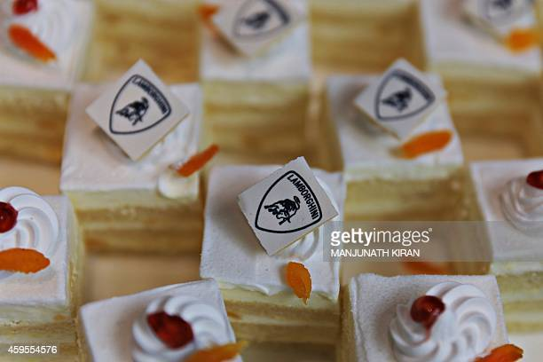 The Automobili Lamborghini logo is seen atop a cake during the launch of Italian car maker's dealership in the Indian city of Bangalore on November...
