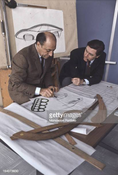 The automotive entrepreneur and industrial designer Sergio Pininfarina and his brother in law the engineer Renzo Carlo are studying in their study...