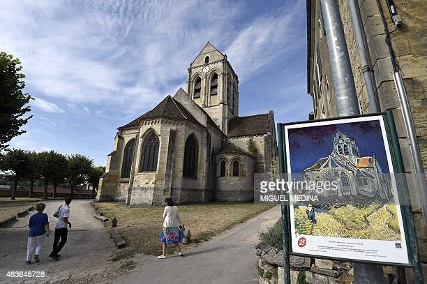 The Auvers Church stands behind a replica of The Church at Auvers by Dutch painter Vincent Van Gogh depicting the church in AuverssurOise in the...