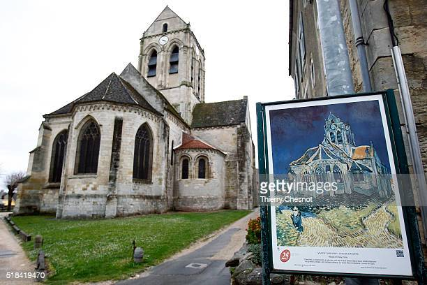 The Auvers Church stands behind a replica of The Church at Auvers by Dutch painter Vincent Van Gogh depicting the church on March 31 2016 in...