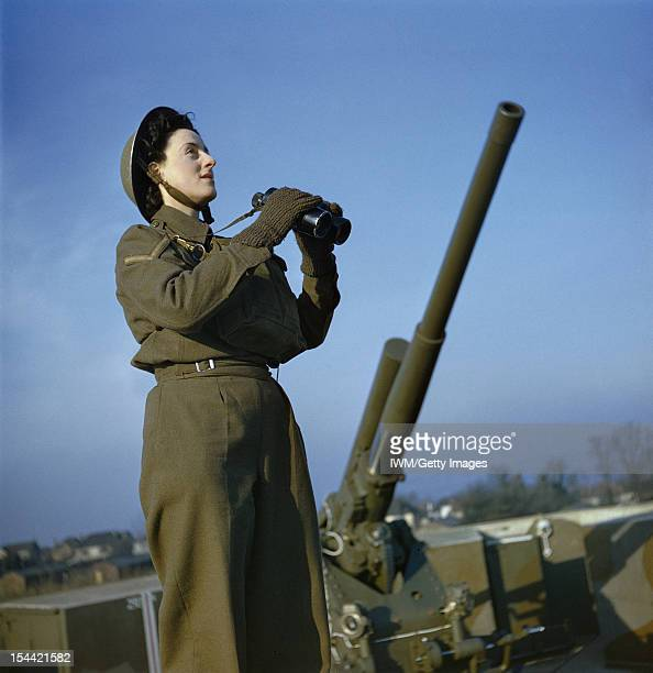 The Auxiliary Territorial Service At An Anti-Aircraft Gun Site In Britain, December 1942, ATS spotter with binoculars at the anti-aircraft command...