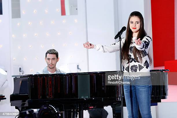 The Avener, Tristan Casara, and singer Marina Kaye perform during the 'Vivement Dimanche' French TV Show at Pavillon Gabriel on June 2, 2015 in...