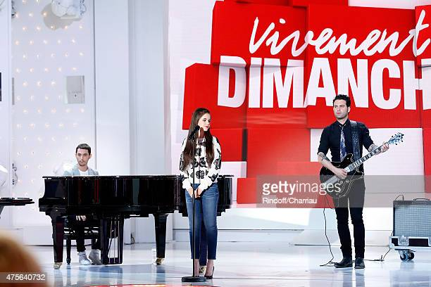The Avener Tristan Casara and singer Marina Kaye perform with Singersongwriter Manu Lanvin during the 'Vivement Dimanche' French TV Show at Pavillon...
