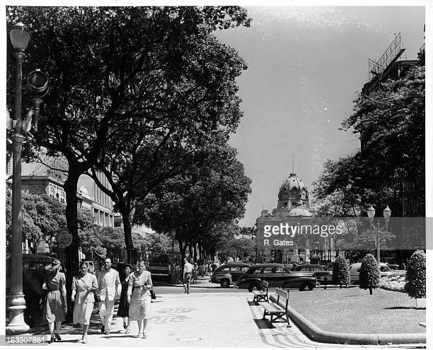 The Avenida Rio Branco people walking on this busy urban street that crosses the center of city of Rio De Janeiro in Brazil 1955