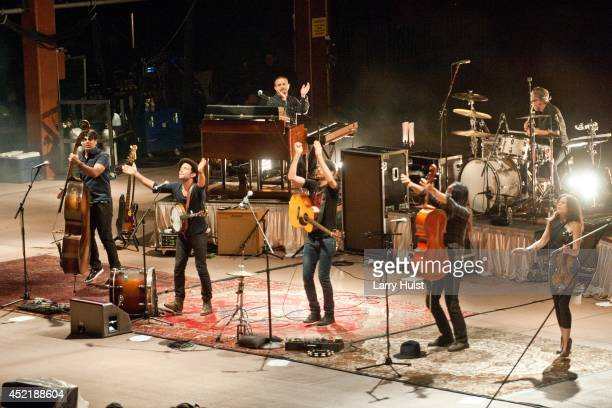 The Avett Brothers performing at Red Rocks Amplitheater in Morrison Colorado on July 11 2014